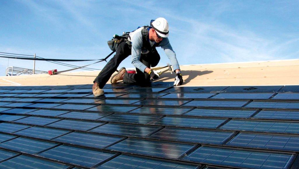 Installer-Working-On-Roof-Tiles