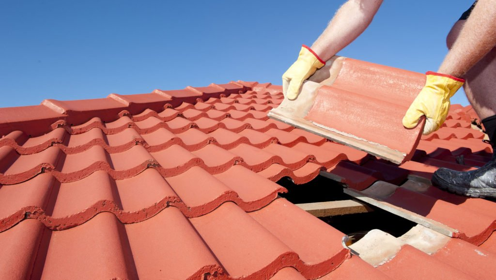 Person-Installing-Roof-Tiles