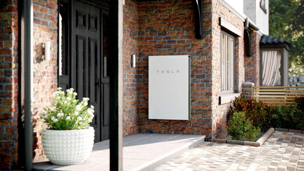 White-Tesla-Powerwall-On-The-Wall-Of-The-House