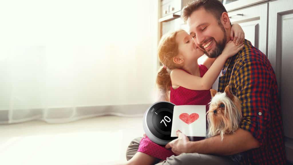 A-Man-Holding-Nest-Thermostat